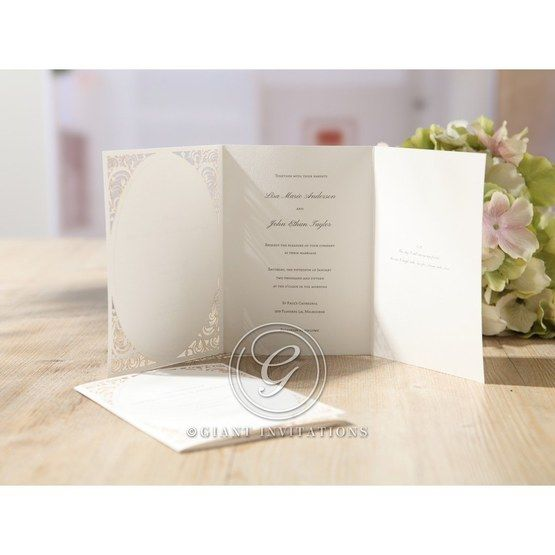Three paneled white wedding invitation featuring laser cut design and raised lettering