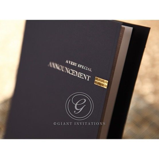 Thermography printed white matte pages in dark blue folded invitation featuring foil stamp cover