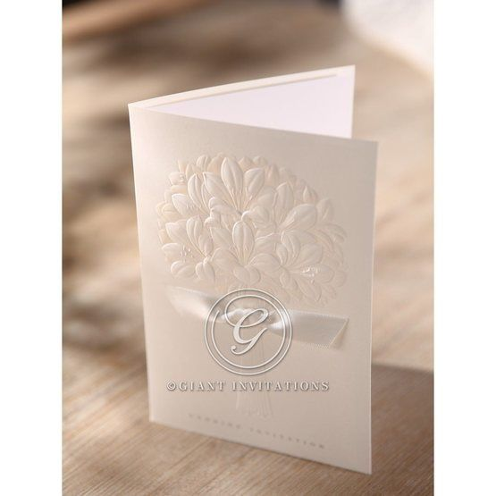 White embossed ribboned flower , top view