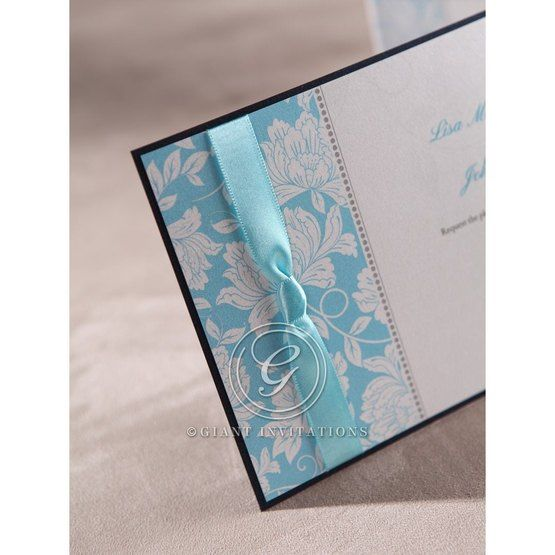 Blue floral design,blue ribboned flat layered wedding card, closeup, cropped