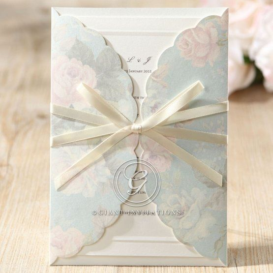 Floral patterned silk screened pocket wedding invitation with silk satin ribbon embellishment