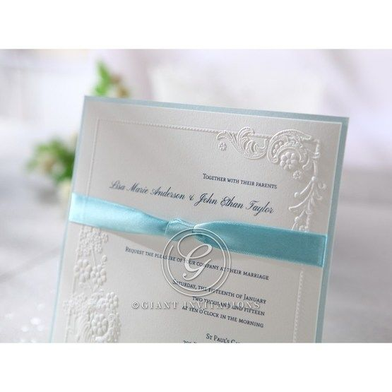Classic white paper featuring a blue backing layer with matching satin blue sash