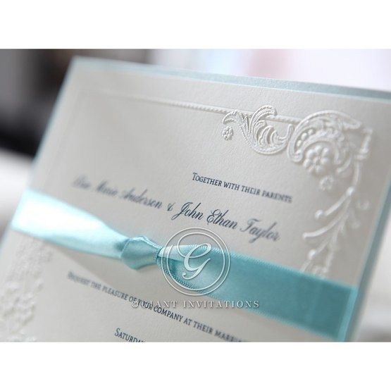 Layered style invitation with thermography print, blue knotted ribbon , embossed floral design