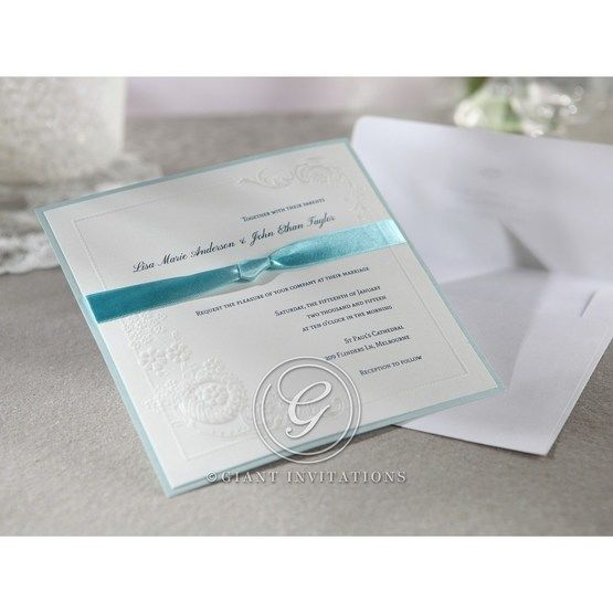 White layered invitation featuring a satin knotted sash and matching envelope