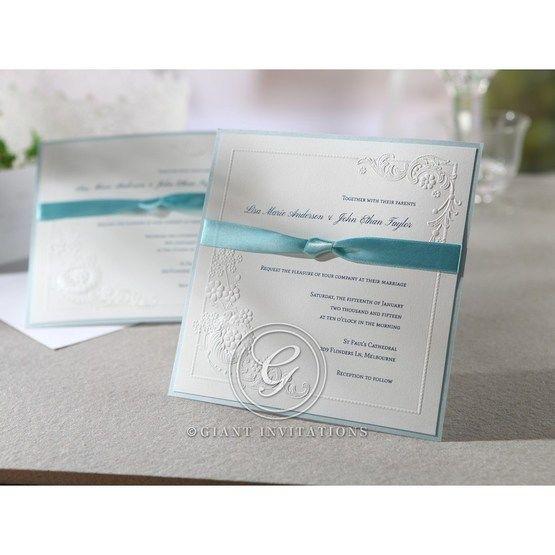 Square white invitation feauturing satin blue wrap,