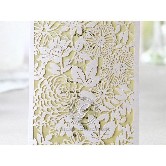The garden laser cut pattern in close up view against the yellow green inner card