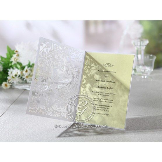Opened rectangular nature inspired wedding invitation with beige inner paper, full view