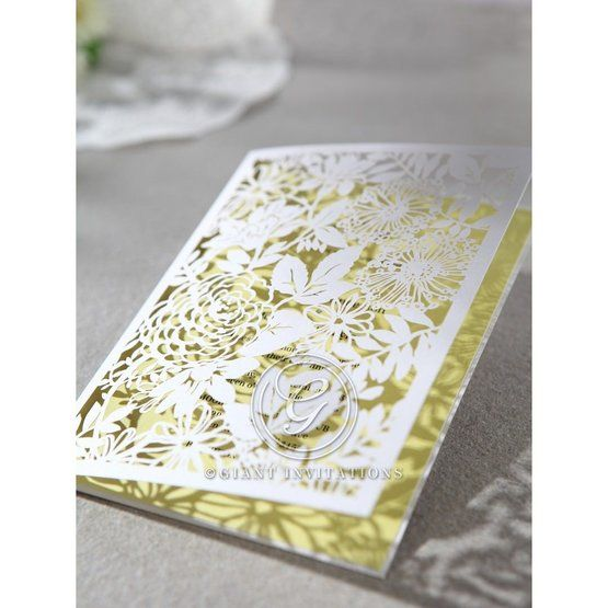 Folded laser cut detail, wedding invitation with beige inner card