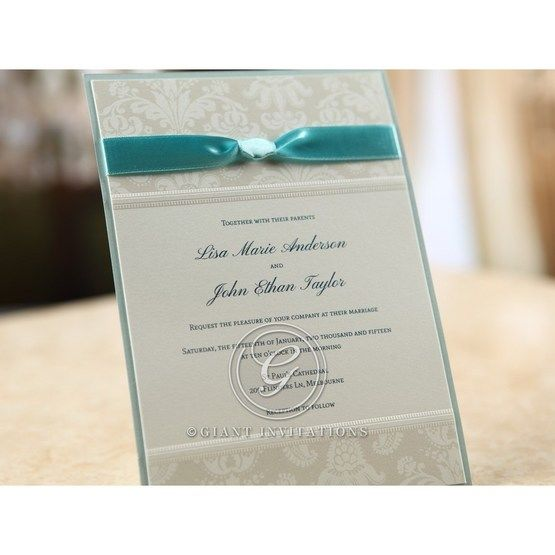 Blue layered wedding invite with white silk screened pearl paper and matching satin band