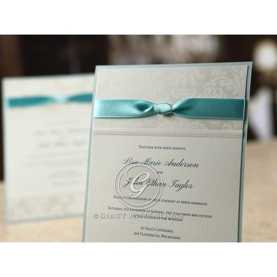 Classic blue wedding invitation with satin silk ribbon and raised ink lettering