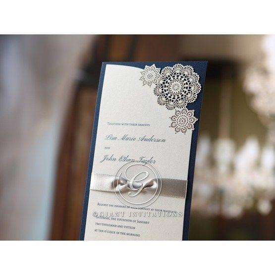 Slender wedding invitation with dark blue back paper, lace style floral laser cut design