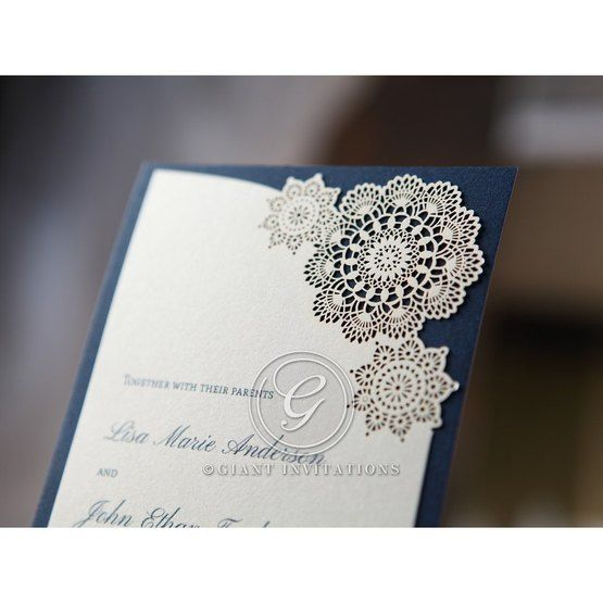 Lace floral laser cut detail in closer view, thermography printed white card on blue backing paper