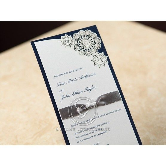 Cropped flat layered card with white laser cut flower accent on dark blue paper