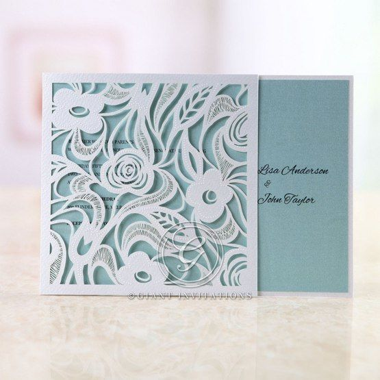 Folded  floral wedding invitation, lasercut, blue inner paper, thermography printing