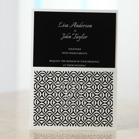 White laser cut pocket with white printed black invitation, geometric patterned
