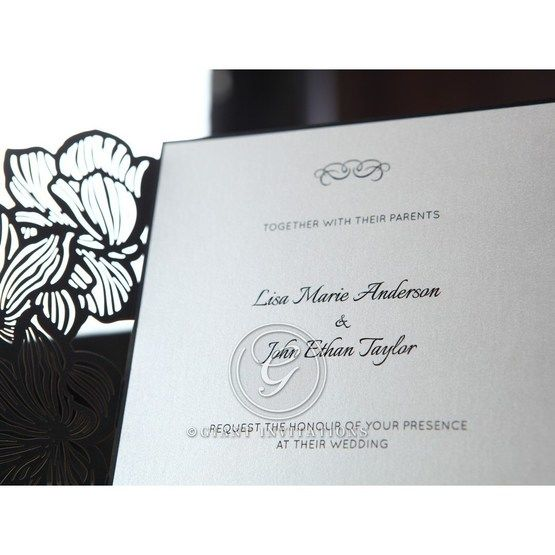 Black floral invitation, white inner card with black raised ink