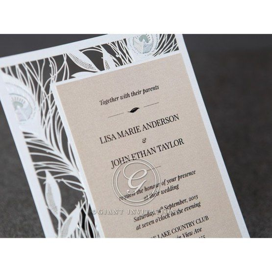 White laser cut bordered invitation with shimmer paper, raised ink lettering in black