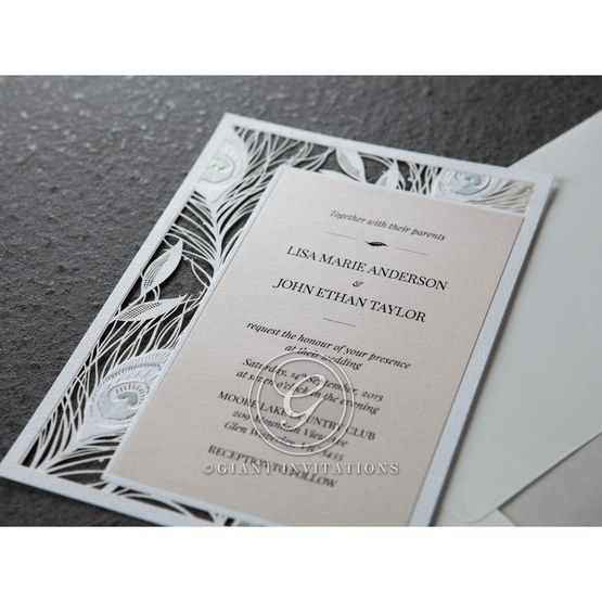Rectangular laser cut wedding invitation with white peacock designed frame accent