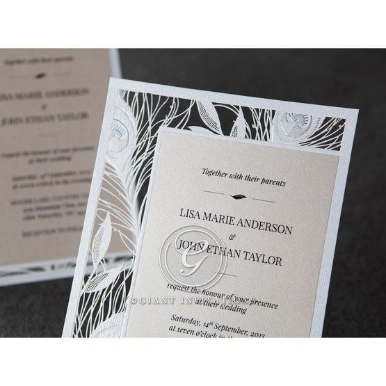 Thermography printed wedding invitation with laser cut border featuring peacock feathers