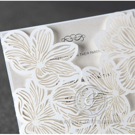White floral laser cut invitation with gatefold, white inner paper front