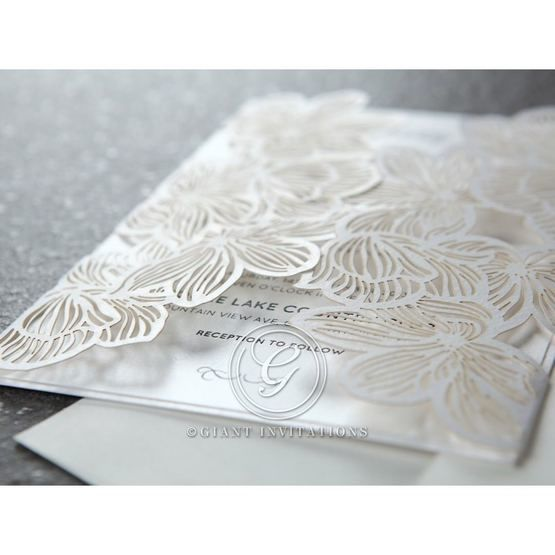 White floral laser cut invitation with gatefold, white inner paper, cropped corner