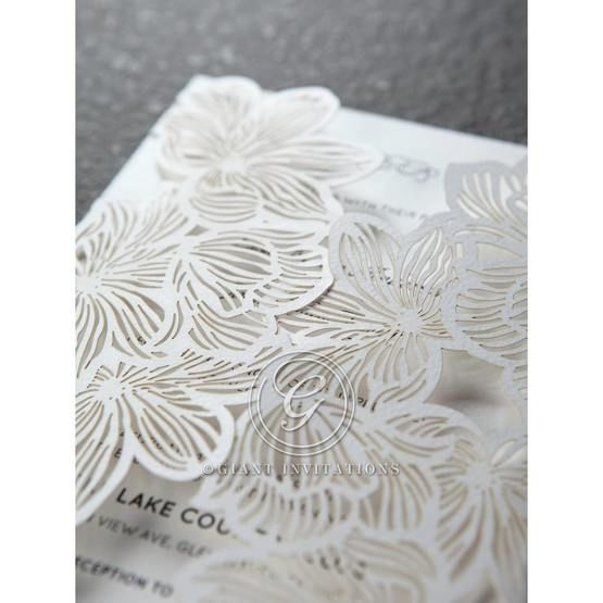White gatefold laser cut design with white card, folded