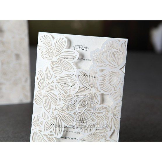Laser cut gatefold invitation with white inner paper
