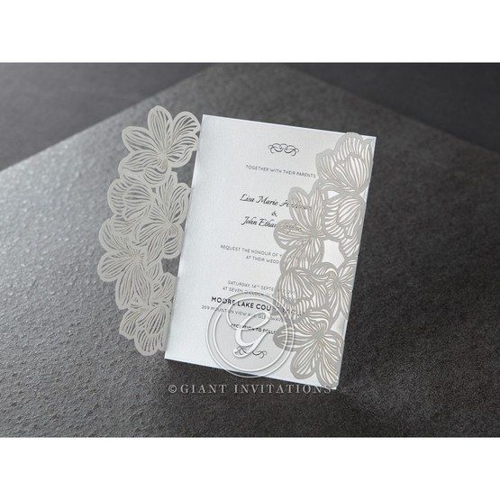 White floral laser cut with open gatefold, white inner paper