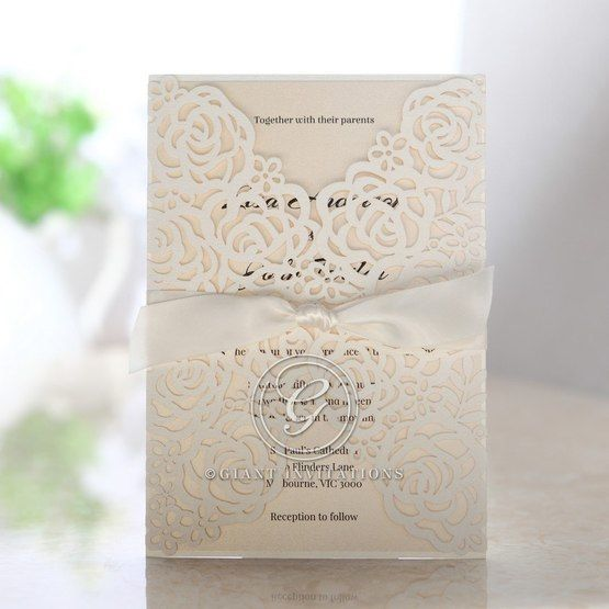 Floral gatefold; white laser cut invitation; beige inner paper; ribboned
