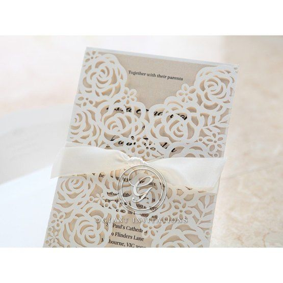 Cropped floral gatefold; white laser cut invitation