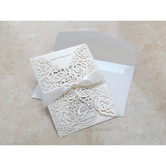 Ribboned laser cut floral invitation; ivory inner paper
