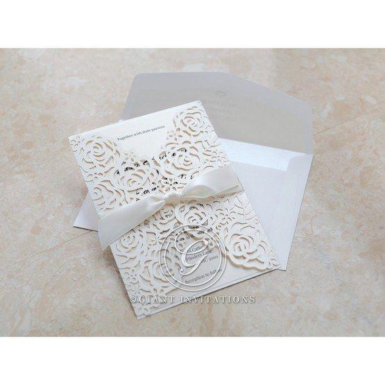 Ribboned laser cut floral invitation; ivory inner paper
