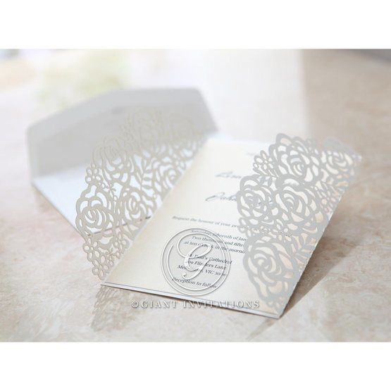 Open floral gatefold invitation with ribbon