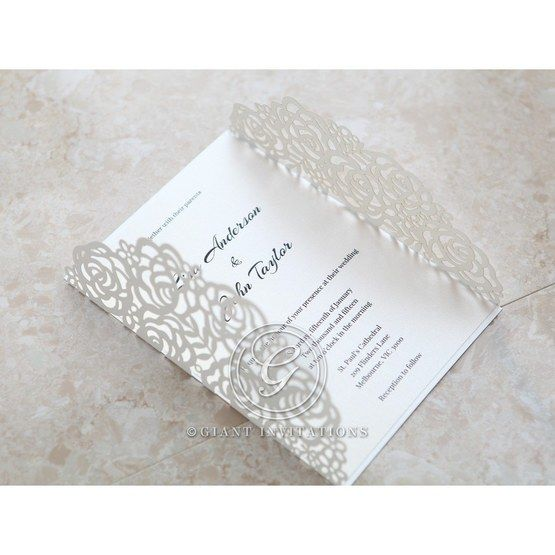 White laser cut card in beige inner card; opened flaps