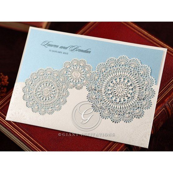 White lasercut floral pocket invitation with blue inner paper