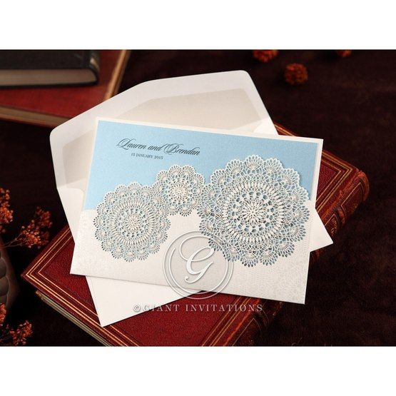 White half pocket wedding invitation with Victorian doily patterns and lace trim