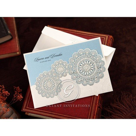 White pocket style lasercut wedding invitation, blue inner paper, matte white pocket, floral lace design, with envelope