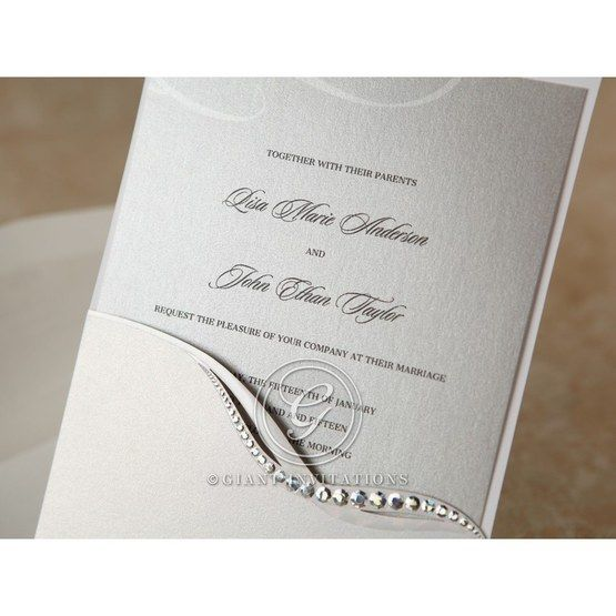 Close up view of the pocket invitation with raised black lettering against a metallic shimmer inner paper