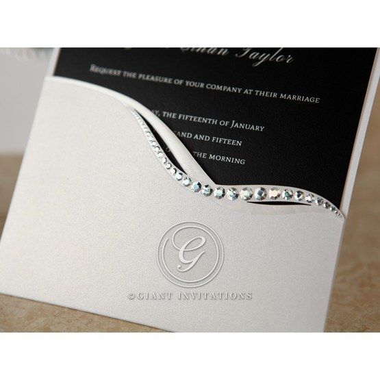 Jeweled half pocket invitation in white featuring black swirl patterned inner paper