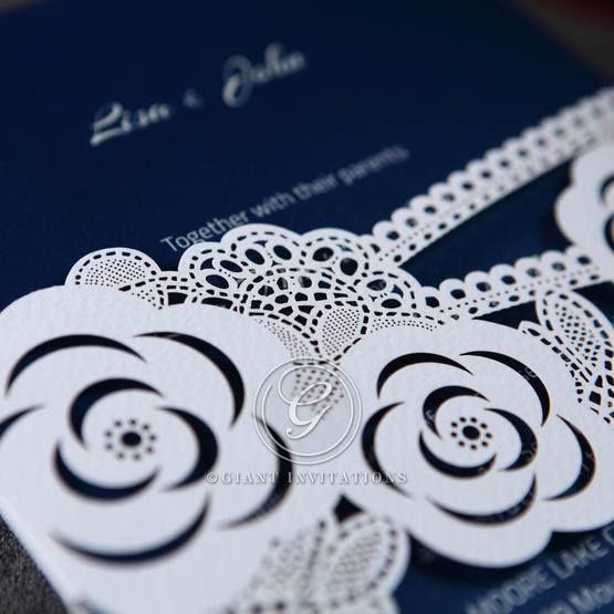 Laser cut modern detailed wild flower designed white colored pocket invite ,closeup