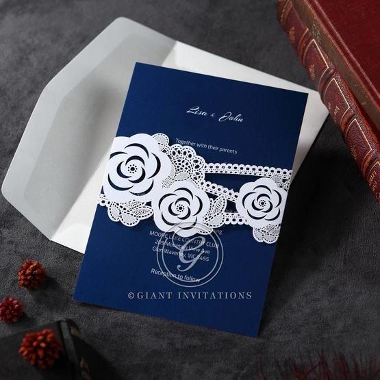 Wild flower designed sash like pocket invite, laser cut with digital printing in white ink, dark blue inner card and envelope