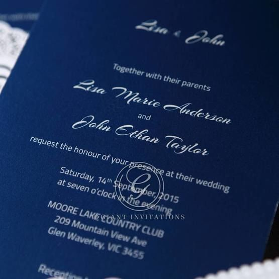Formal wedding invite featuring custom text in flat ink and floral sash