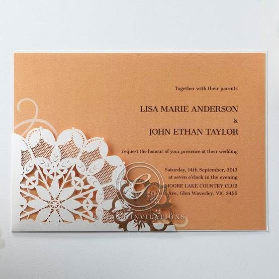 Floral patterned laser cut pocket invitation with orange inner paper