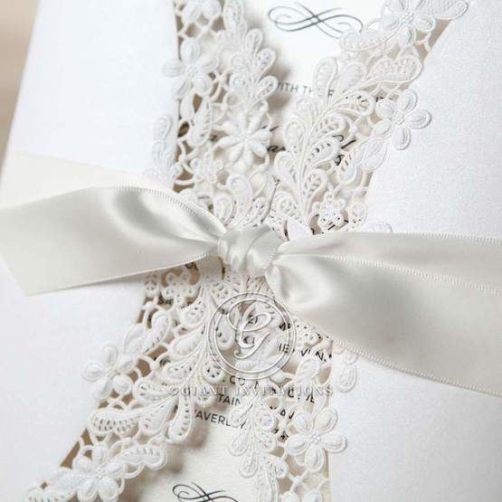 Cropped ribbon and laser cut detail of the ivory laser cut pocket