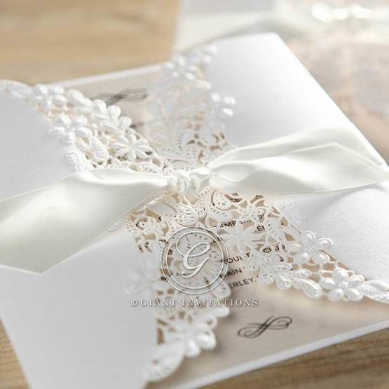 Wrapped white wedding invitation with flowers and raised ink cream insert