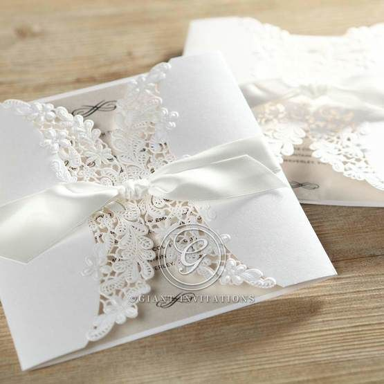 Ribbon wrapped laser cut invitation featuring thermography printing; square