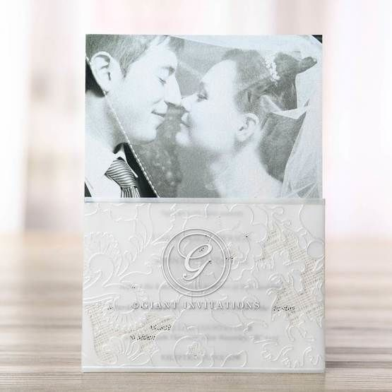 Silkscreened embossed photo invitation, white sleeve, folded, thermography