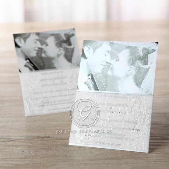 Full view of the white photo invitation accented with embossed flowers