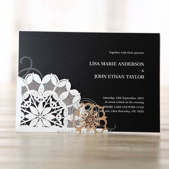 Floral patterned laser cut wedding invitation with black insert featuring digital print and faint swirl watermark design