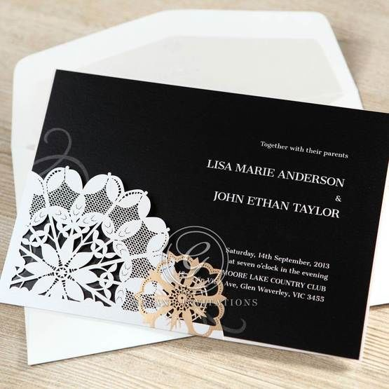Black and white floral laser cut wedding invitation feauturing digital printing on black shimmer paper
